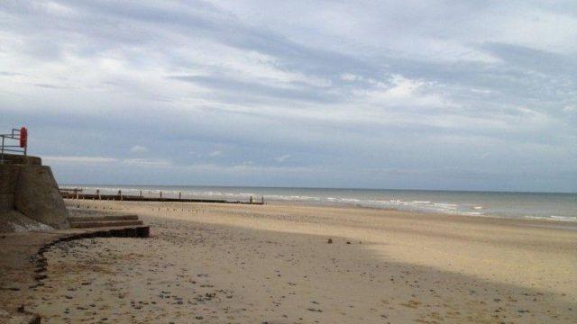 Dog walk at Mundesley Beach