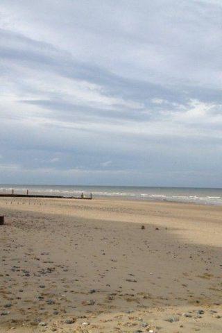 Dog walk at Mundesley Beach photo